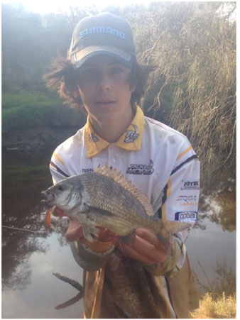 YOUNG GUN TRENT WITH A SOLID BREAM CAUGHT ON LURE