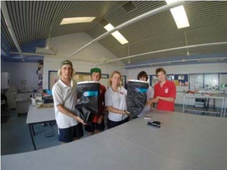 Sean Parks works alongside fellow students during the Marine Tourism Program at high school to create new dive bags.