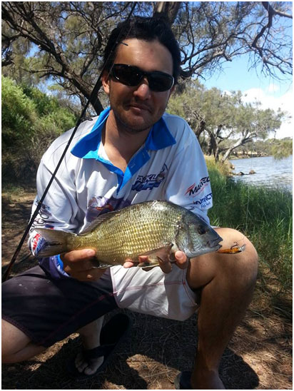 DANIAL WITH A SOLID 35CM PB BREAM ON HARD BODY LURE