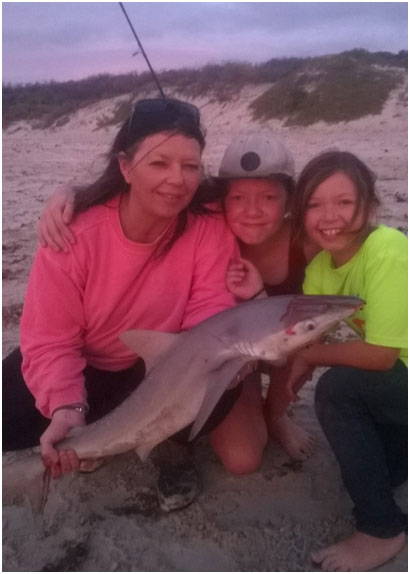 THE BRIMMER FAMILY HAVING CUDDLE WITH A NICE SHARK