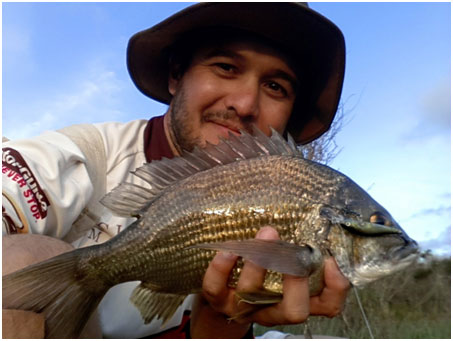 DANIAL WITH HIS 38CM PB BLACK BREAM TAKEN ON A STRADA VILLAIN 55