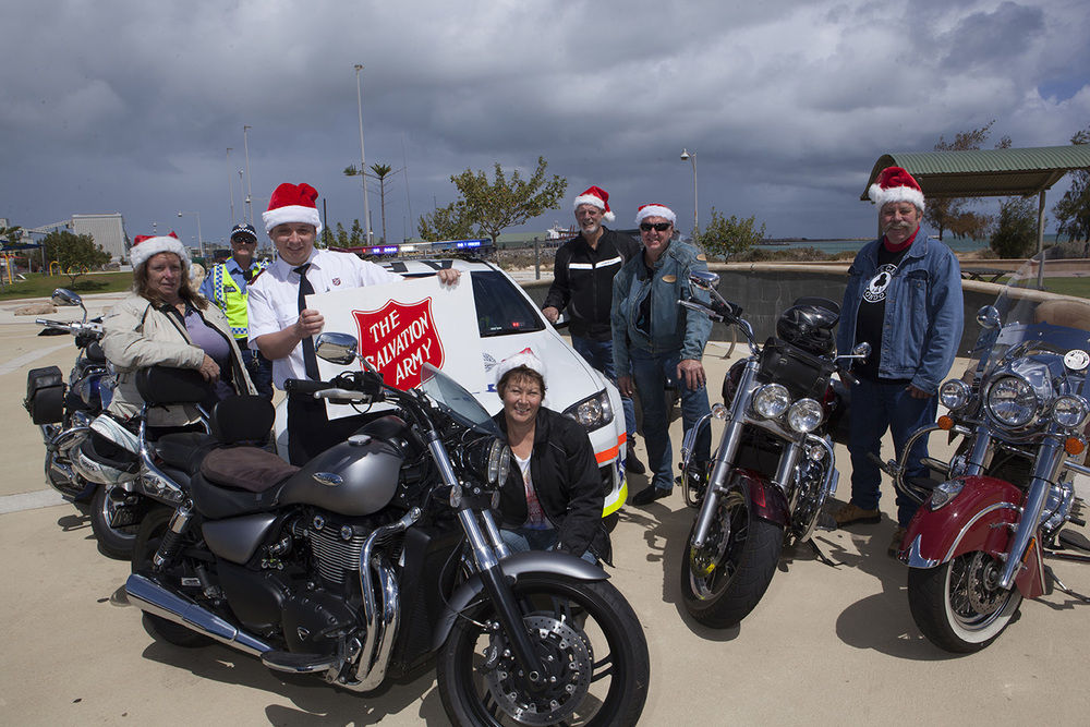 Riding escort: Lt Jeff Milkins of Salvation Army Geraldton met to discuss the Salvation Army Toy Run with Snr Const Darryl Peden and Santa's Helpers from the Ulysses Club; from left, Dale Clifton, Linda King (kneeling), Cyril McKenzie, John Norton and Terry Marsden. Picture: Contributed.