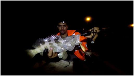 PATRICK WITH A NICE COD TAKEN ON THE X-RAP SPLASH BAIT