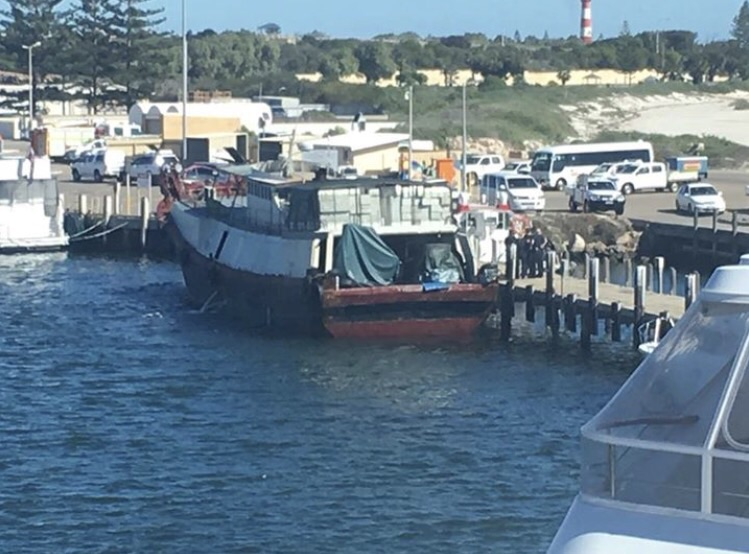 """Image: Mark Guidice. """"All happening down at the wharf. Customs and Police swarming over this boat."""