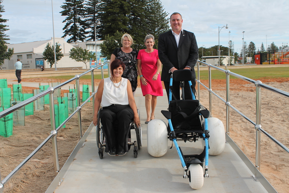 'Count Me In' Regional Ambassador Chris Kerr, CEO Mid West Community Living Association Angie Phillips, Geraldton Manager Disability Services Commission Sheena Byrne and Mayor Shane Van Styn test drive the new ramp.