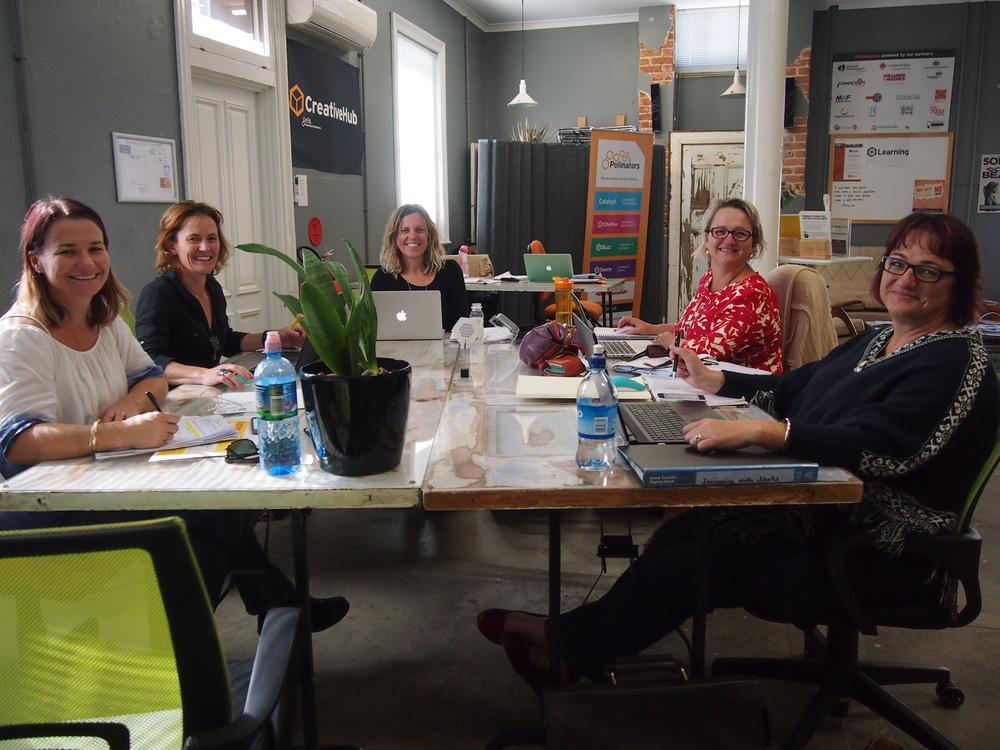 Members of purpose coach Fleur Porter's Incubators program at work in Pollinators' coworking spaces. Pictured are Kym Duncan, Kate Tonkin, Fleur Porter, Carolyn Correll and Clara Harris.