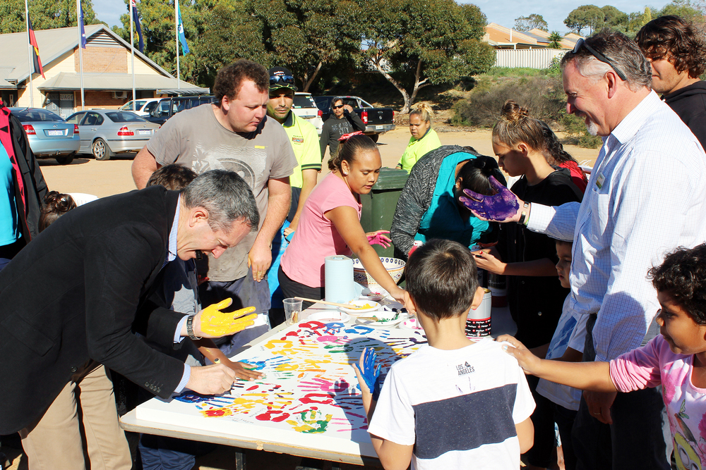 Regional Development Minister, Terry Redman, leaves his mark with local children at a family fun day at Bundiyarra last month, ably aided by Nationals Member for the Agricultural Region, Paul Brown, right.