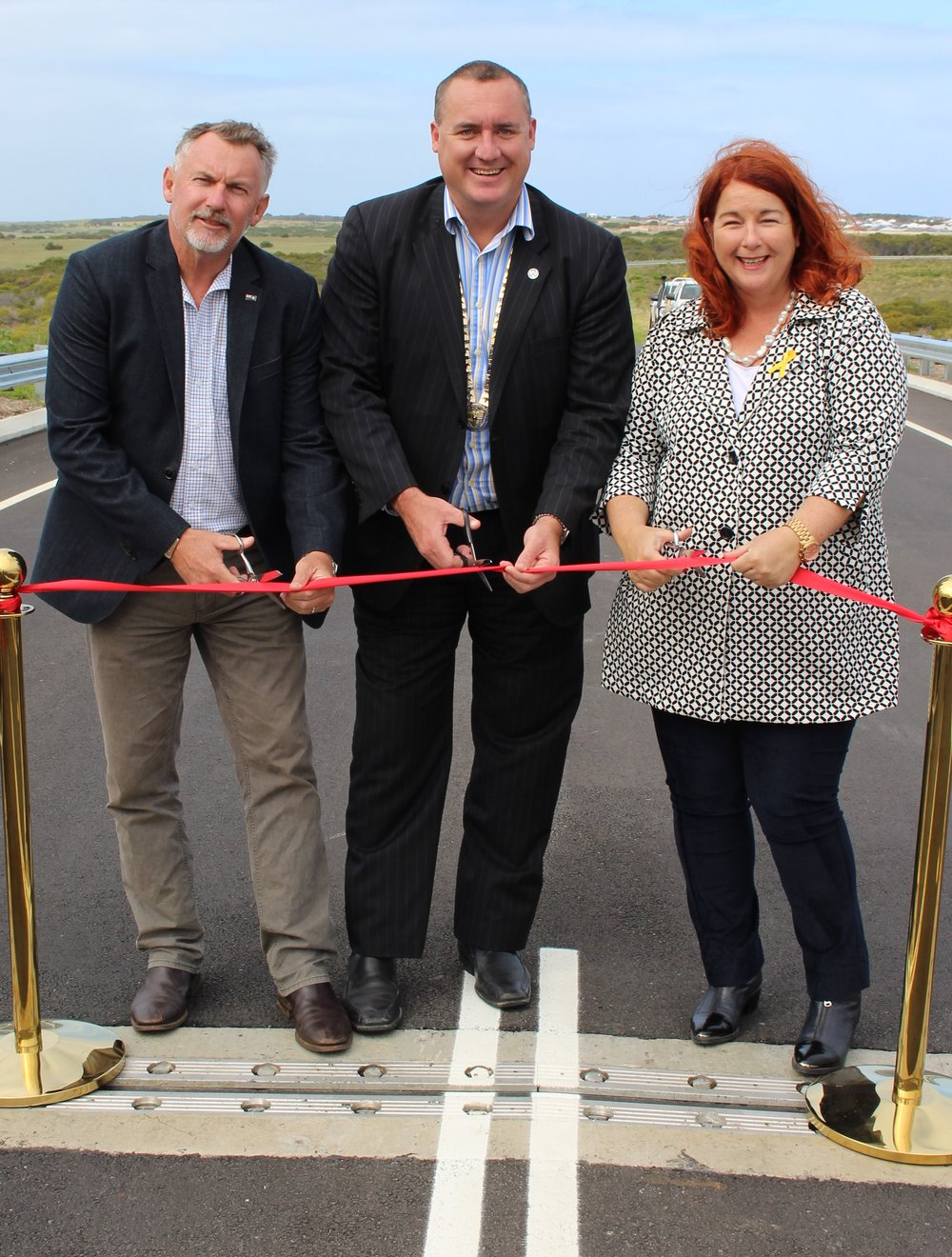 Member for Agriculture the Hon. Paul Brown MLC, City of Greater Geraldton Mayor Shane Van Styn and Federal Member for Durack Melissa Price MP cut the ribbon - officially opening the Abraham Street bridge.