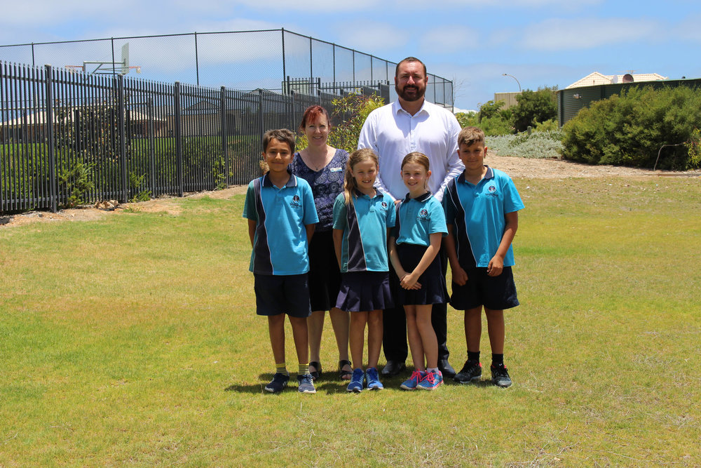 Wandina Primary School Principal Di Miller and City of Greater Geraldton Mayor Shane Van Styn are joined by year three and year five students on the proposed site of a nature playground located on both school land and City owned land in Derna Park.