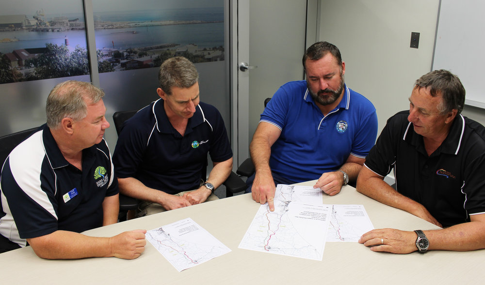 Shire of Irwin Acting CEO Geoff Peddie (left) Shire of Chapman Valley Deputy CEO Simon Lancaster, City of Greater Geraldton Mayor Shane Van Styn and Shire of Northampton CEO Garry Keeffe finalising their proposed Dongara-Northampton Transport Corridor route.
