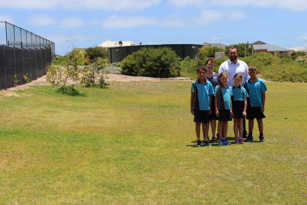 Wandina Primary School Principal Di Miller and City of Greater Geraldton Mayor Shane Van Styn are joined by Wandina Primary students on the future site of the Derna Park nature playground.