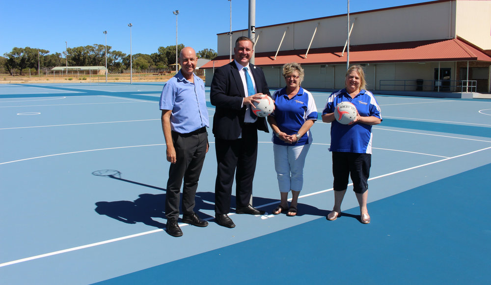 From left, DLGSC Regional Manager Mid West Gascoyne-Sports and Recreation Richard Malacari, City of Greater Geraldton Mayor Shane Van Styn, Geraldton Netball Association Administrator Charlotte van Jaarsveldt and Geraldton Netball Association President Janniel Harris on the outdoor netball courts which were recently resurfaced with the assistance of grant funding from both the City and State government.