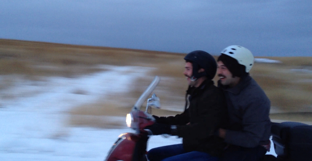 Alex Cox (on the left, at the wheel) and Mark Slagle (on the back, with the white helmet).