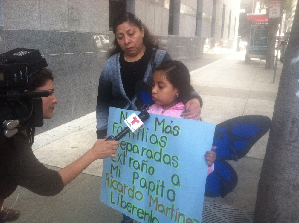 "Ricardo's daughter being interviewed at a rally for her dad in front of ICE in San Francisco, with sign, ""No mas familias separadas.  Extrano a mi papito, Ricardo Martinez.  Liberenlo.""  (English: No more families separated.  I miss my daddy, Ricardo Martinez.  Free him.)"