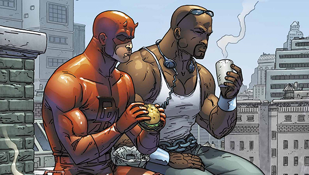Daredevil and Luke Cage share a rooftop meal on the cover of  Marvel Team-Up  #9. Art by Scott Kolins. Marvel.