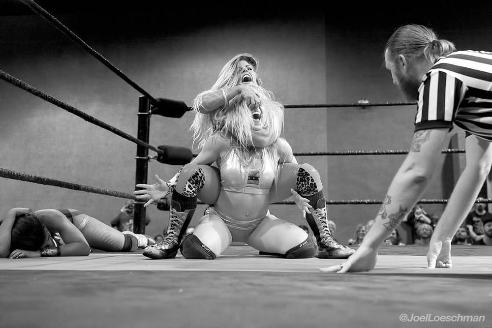 Barbi Hayden rips Kimber Lee's face off, while Athena recovers, in this XX Division Triple Threat Elimination match. Photos by Joel Loeschman.