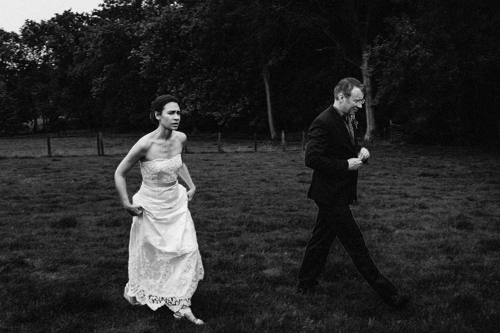 Bride and groom in a field.