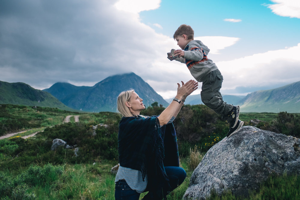 Son jumps off rock into mother's arms