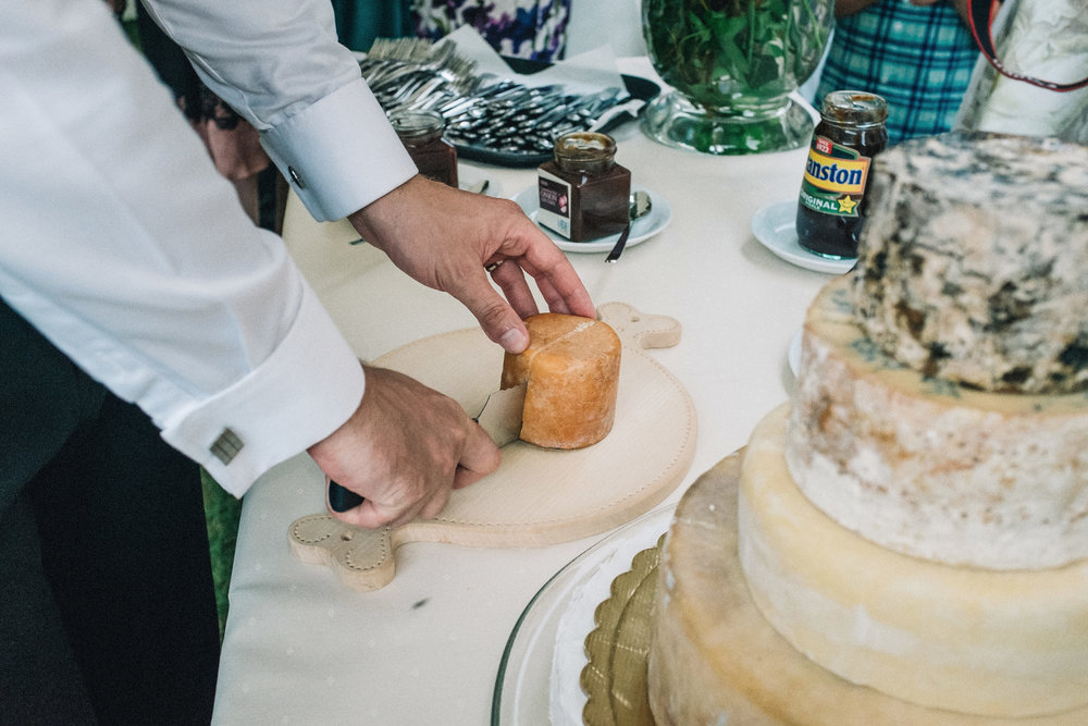 Cutting the wedding (cheese) cake