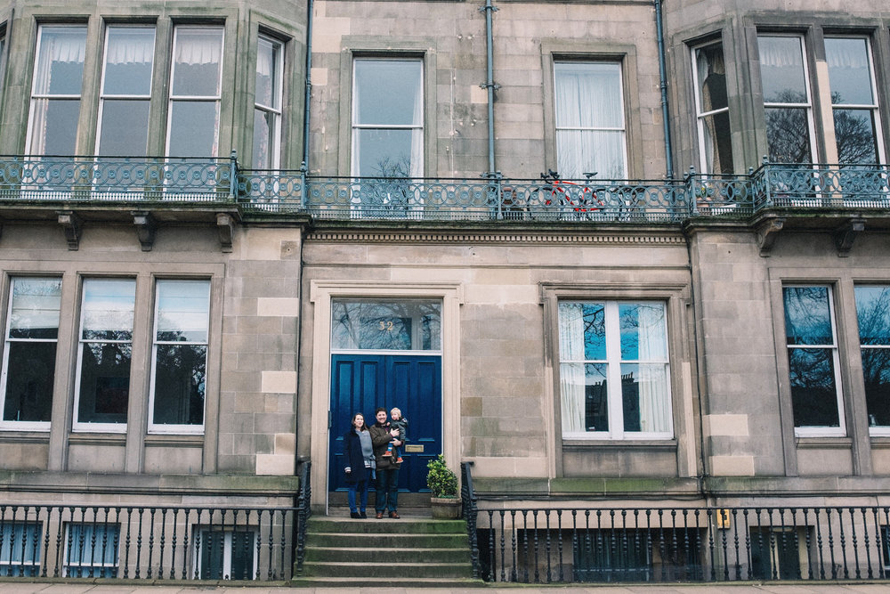 Edinburgh family stand outside their flat