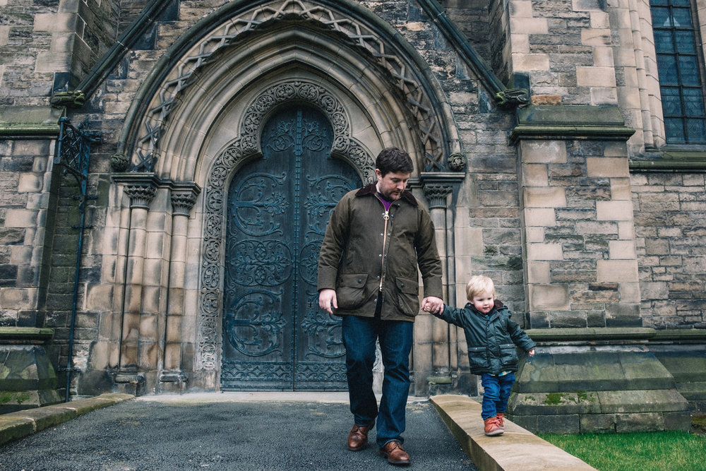 Father holds hand of son outside Edinburgh church