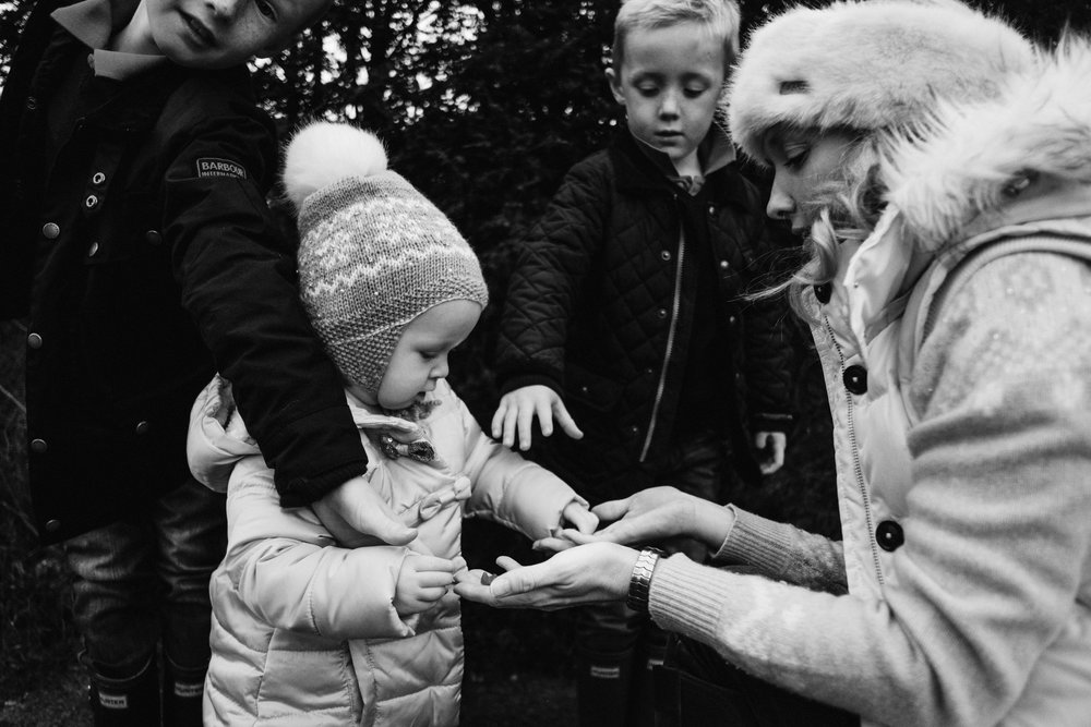 Mother hands out sweets to her children