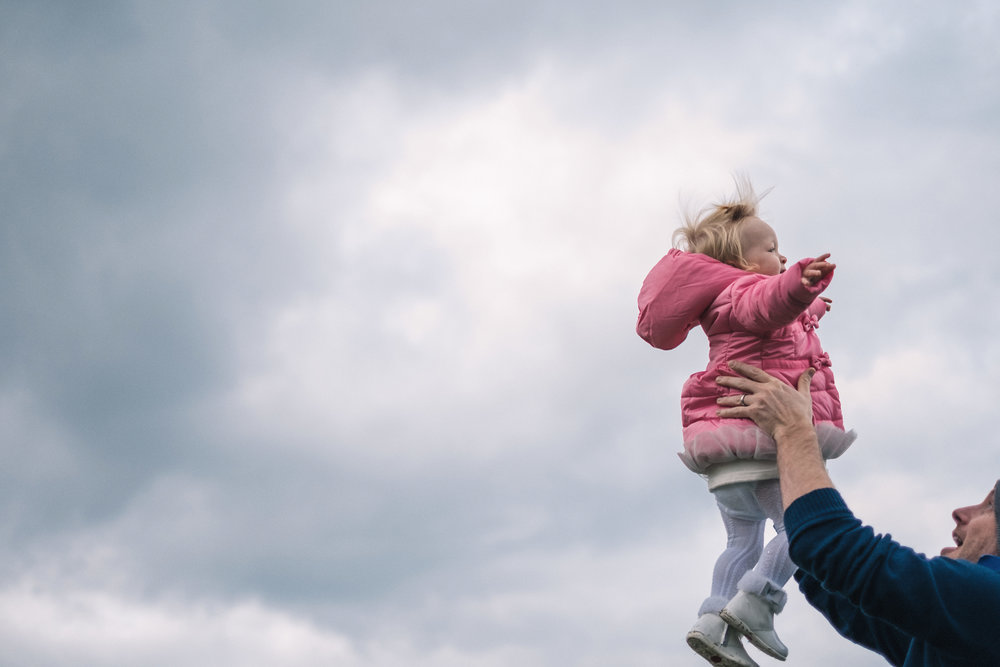 Toddler caught mid-air by father