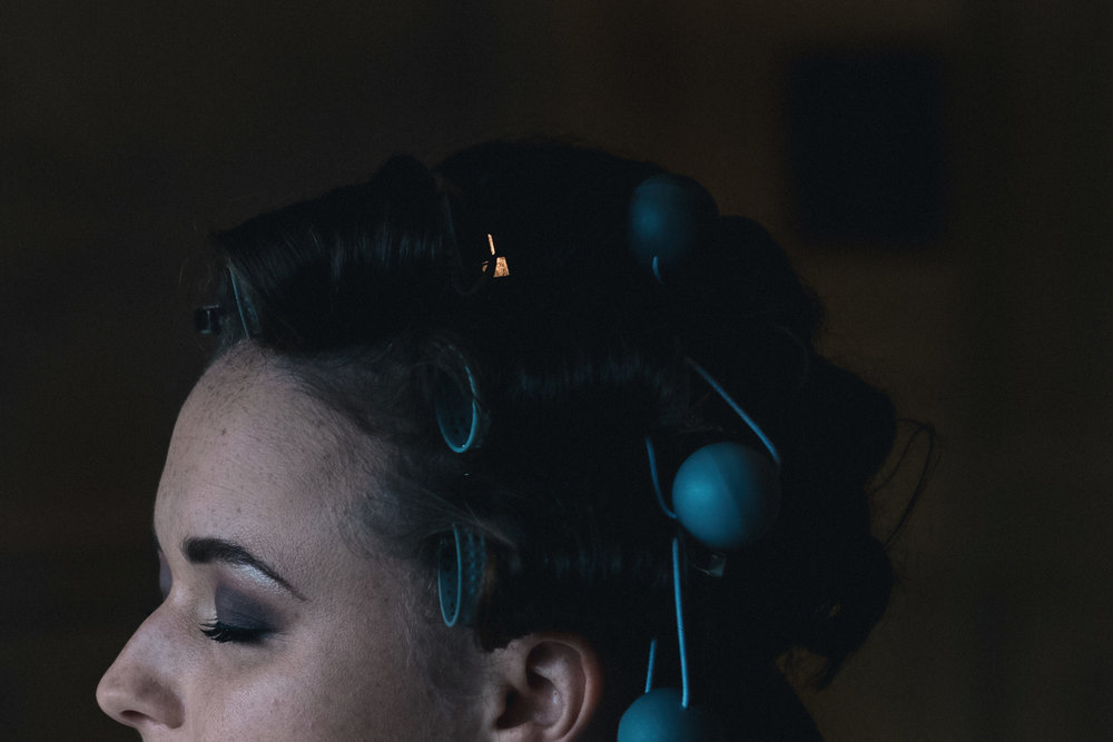 Bride with blue rollers in her hair