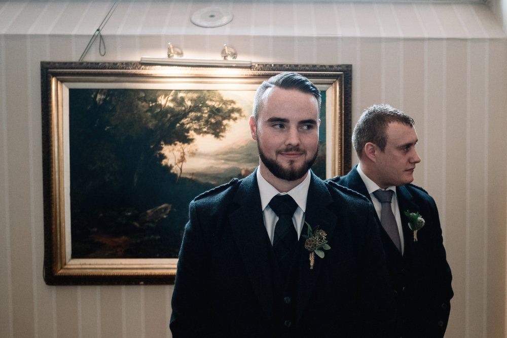 Nervous groom waits on his bride
