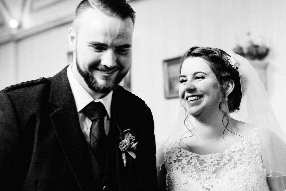 Bride and groom laugh during their ceremony