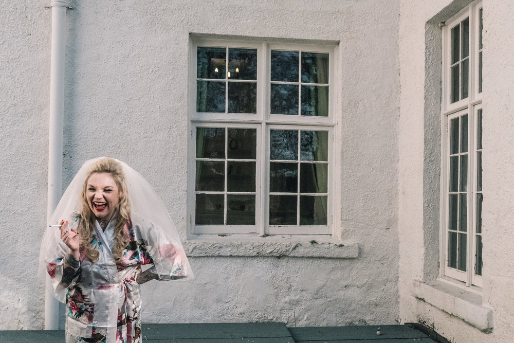 Laughing bride outside