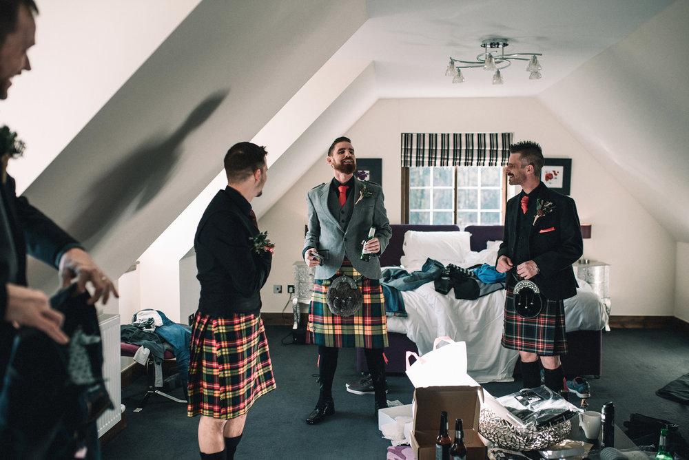 Laughing groom with groomsmen