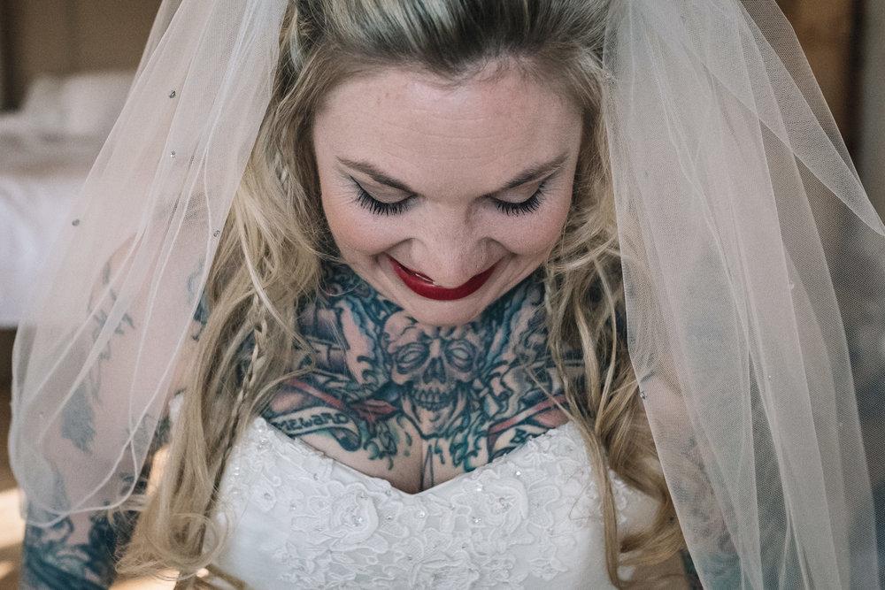 Tattooed bride smiles