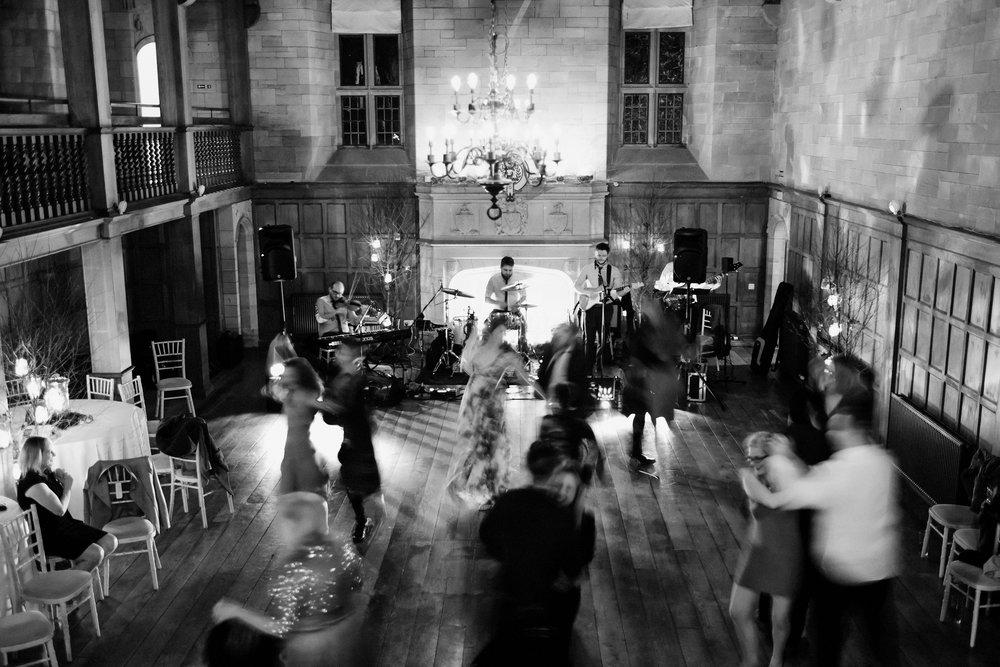 Full dance floor of moving ceilidh dancers