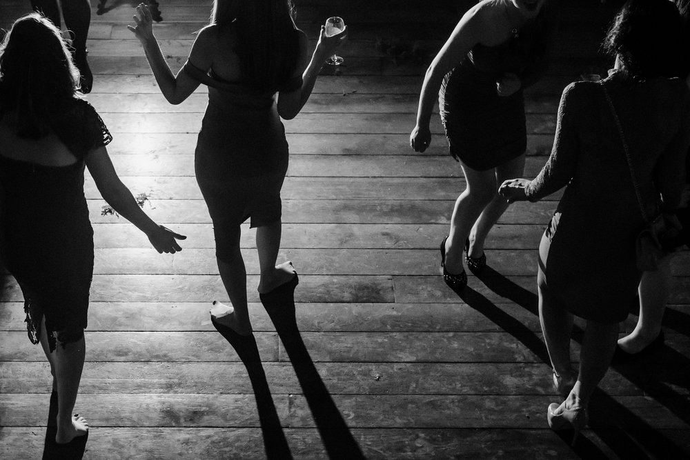Silhouetted dancers on the dance floor