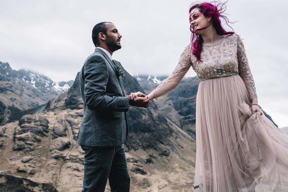 Bride + groom holding hands