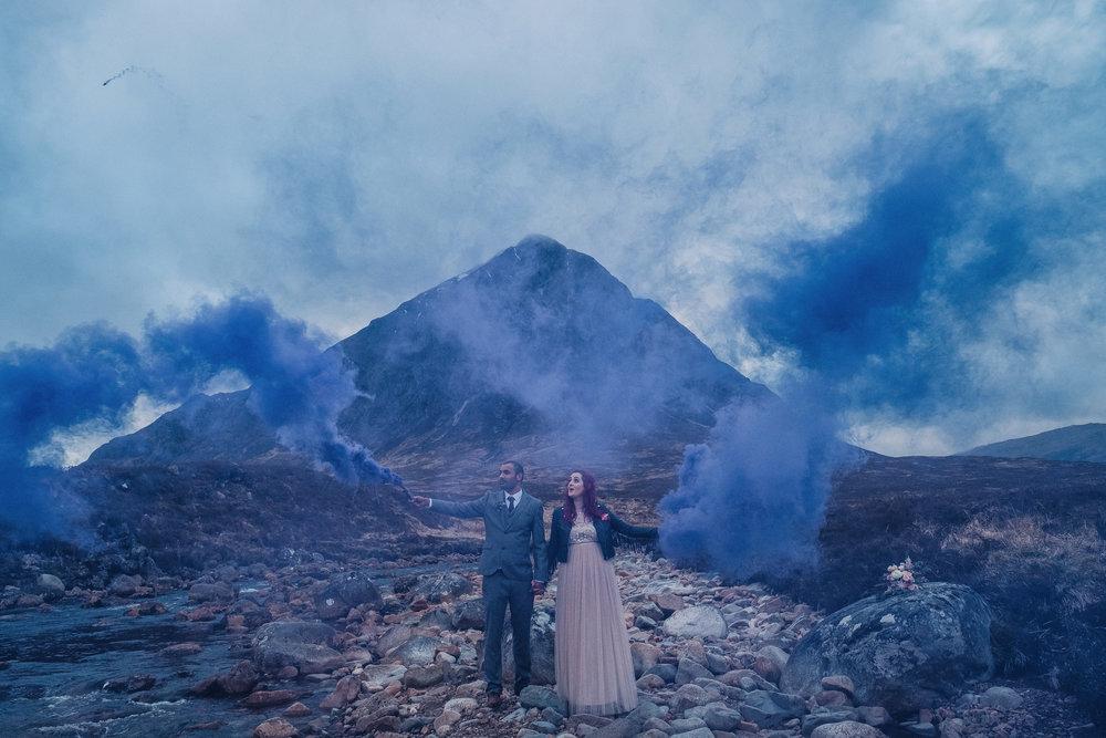 Couple holds purple smoke bombs in Glencoe