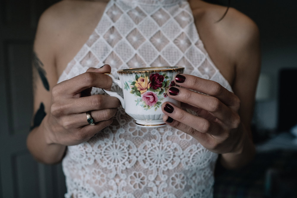 Bride holds tea cup