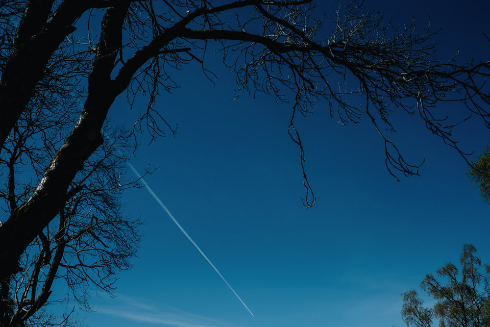 Blue skies with trail of a flight path