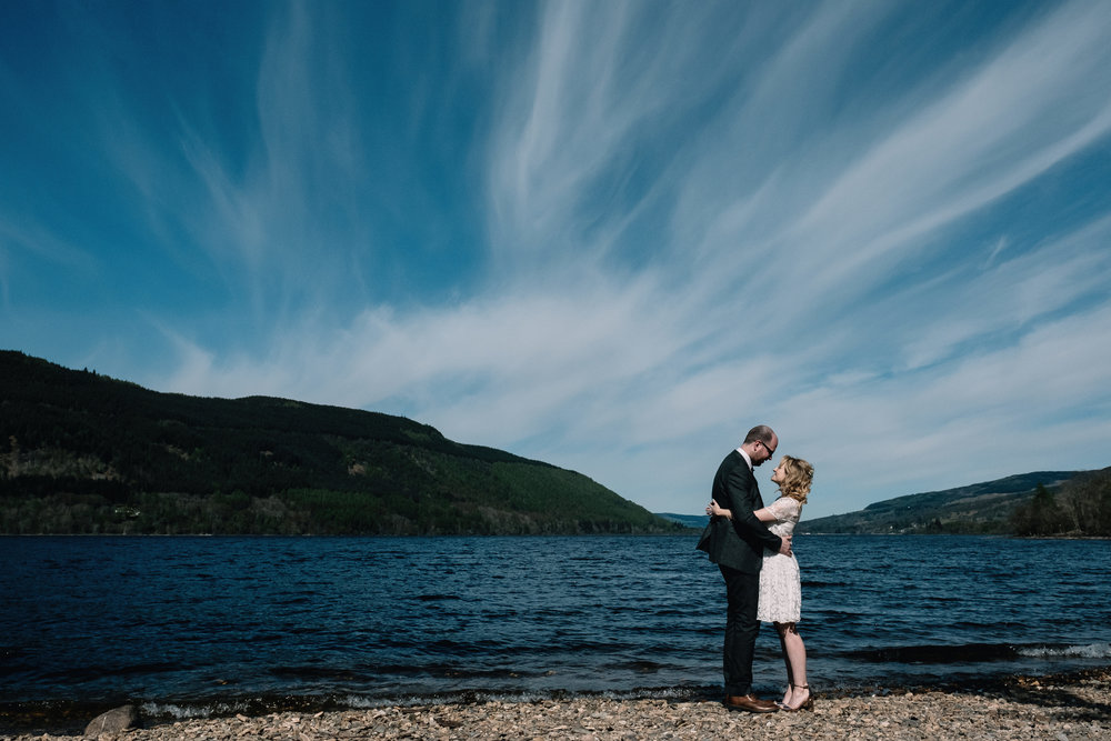 Newly weds standing on banks of Loch Tay