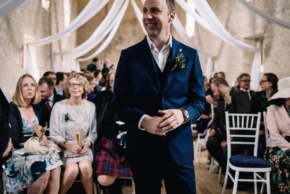 Groom waits on bride arriving