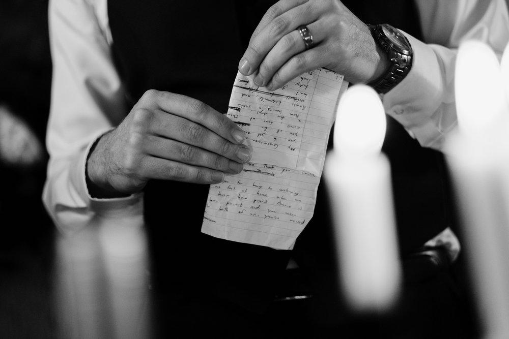 Groom holds speech notes