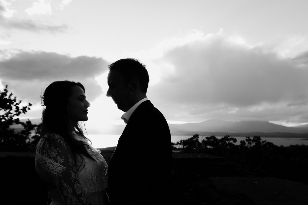 Silhouette profile shot of bride and groom