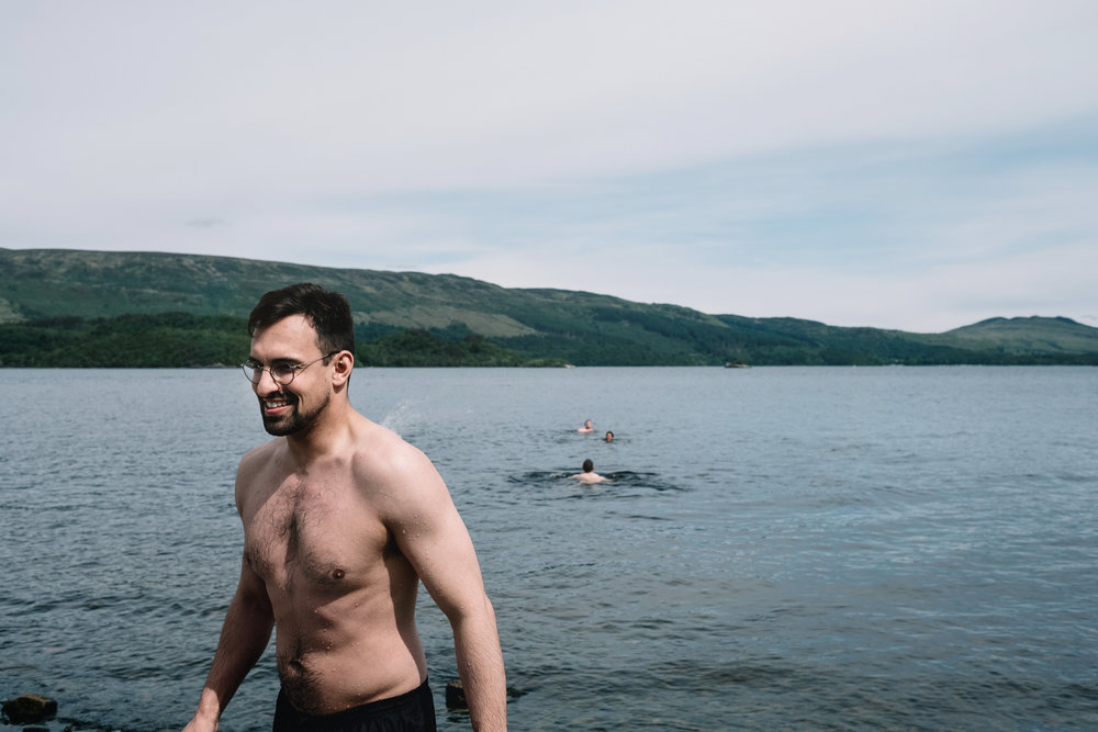 Wedding guest swimming in Loch Lomond