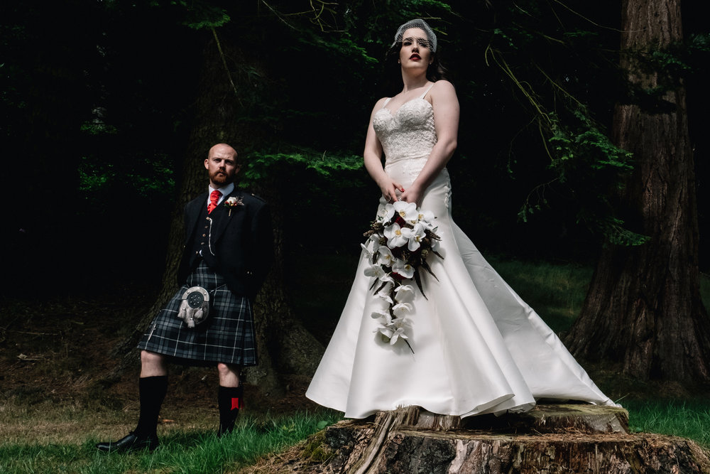 Bride and groom stand in forrest