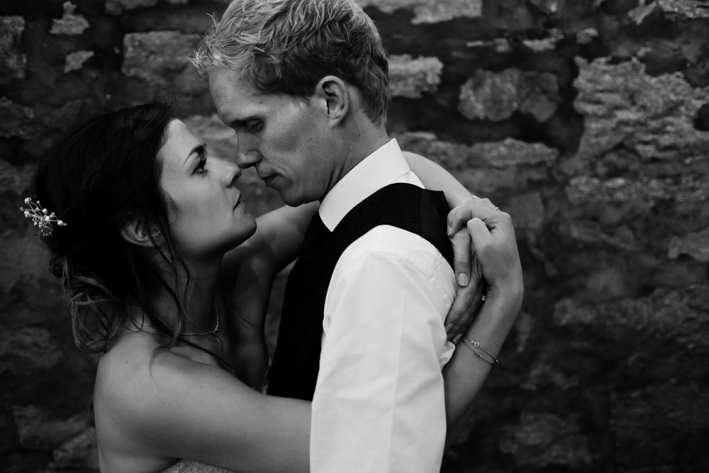 Bride and groom's arms interlocked