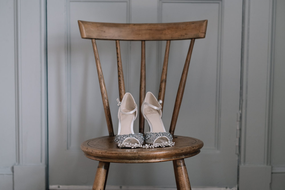 Wedding shoes on a wooden chair