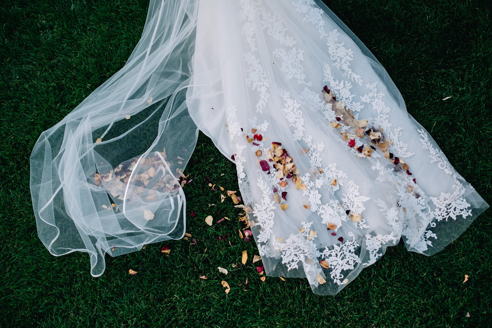 Colourful confetti on wedding dress