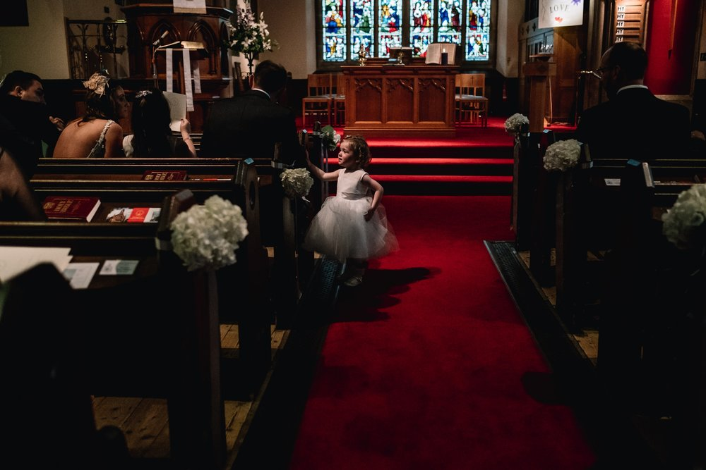 Young wedding guests stands in aisle