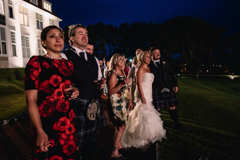 Wedding guests watch fireworks